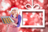 Composite image of festive blonde showing hot cookies — Foto de Stock