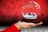 Hand holding santa snow globe — Stock Photo
