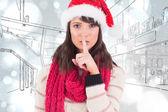 Festive brunette keeping secret — Stock Photo