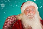 Santa Claus sitting on couch — Stock Photo