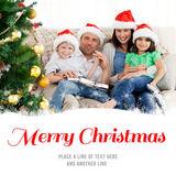 Famiglia a Natale sul sofà — Foto Stock