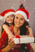 Festive mother and daughter smiling — Stok fotoğraf