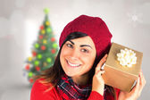 Pretty brunette in hat holding gift — Stock Photo