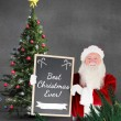 Santa claus showing blackboard — Stock Photo #62490757