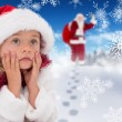 Cute little girl wearing santa hat and tinsel — Stock Photo #62491461