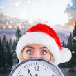 Festive blonde showing a clock — Stock Photo #62491479