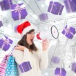 Festive brunette holding megaphone and bags — Stock Photo #62493119