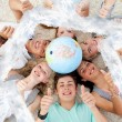 Teenagers on the floor with a terrestrial globe — Foto Stock #62493133