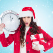Surprised brunette holding clock and gift — Stock Photo #62494355