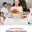 Mother showing turkey for Christmas dinner — Stock Photo #62494577