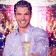 Composite image of man offering champagne — Stock Photo #62494683