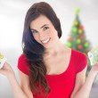 Cheerful brunette holding her cash money — Stock Photo #62495315