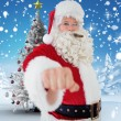 Composite image of portrait of santa with cigar — Stock Photo #62495359