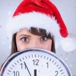 Portrait of a festive brunette holding a clock — Stock Photo #62495433