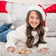 Festive little girl eating cookies — Stock Photo #62495677