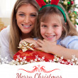 Mother and daughter holding Christmas presents — Stock Photo #62495861