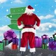 Santa Claus against of empty signposts — Stock Photo #62495949