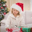Girl surrounded by christmas gifts — Stock Photo #62496475