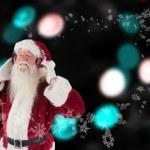 Santa Claus enjoys some music — Stock Photo #62496519