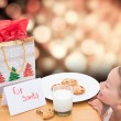Composite image of milk and cookies left out for santa — Stock Photo #62496773