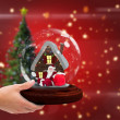 Hand holding snow globe — Stock Photo #62497327