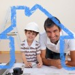 Smiling dad and little boy studying architecture — Stock Photo #62497447