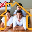 Family in their new house lying on floor — Stock Photo #62497705