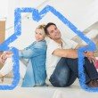 Smiling couple with boxes in a new house — Stock Photo #62497977