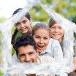 Composite image of happy family in the park — Stock Photo #62498369