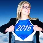 Businesswoman opening her shirt superhero — Stock Photo #62498777