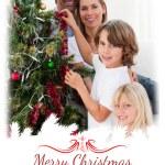 Family decorating a Christmas tree — Stock Photo #62498953