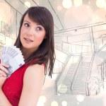 Brunette showing fan of dollars — Stock Photo #62499697