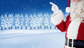 Mid section of santa pointing — Stock Photo