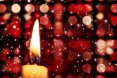 Twinkling stars against candle burning — Stok fotoğraf