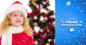 Festive little girl in santa hat and scarf — Stock Photo