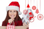 Composite image of woman with gifts — Stock Photo