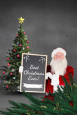 Santa claus showing blackboard — Stock Photo