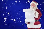 Santa Claus reads list — Stock Photo