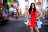 Woman standing with shopping bags — Foto de Stock