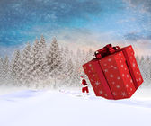Santa delivering large gift — Foto de Stock