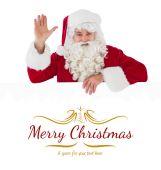 Portrait of santa claus waving — Stock Photo