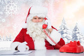 Composite image of santa on the phone — Stockfoto