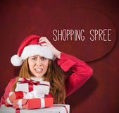 Festive stressed redhead holding gifts — Stock Photo