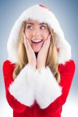 Santa girl with hands on face — Stock Photo