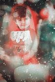 Festive little boy holding gingerbread house — Stock Photo