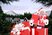 Santa standing in large gift — Stockfoto
