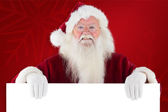 Santa looks over sign — Stock Photo