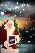 Santa presents tablet PC — Stock Photo