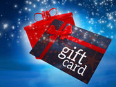 Flying gift card and present — Stock Photo