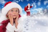 Cute little girl wearing santa hat and tinsel — Foto Stock